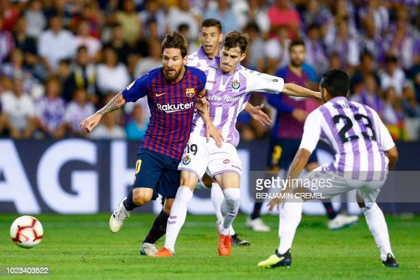 Barcelona's Argentinian forward Lionel Messi vies with Real Valladolid's Spanish midfielder Toni during the Spanish league football match between...