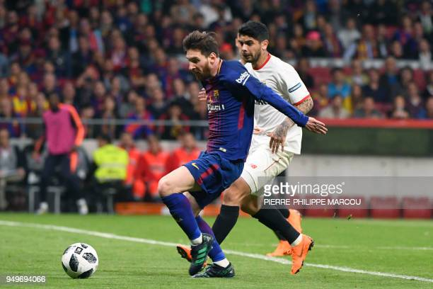 Barcelona's Argentinian forward Lionel Messi vies with Sevilla's Argentinian midfielder Ever Banega during the Spanish Copa del Rey final football...