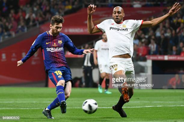 Barcelona's Argentinian forward Lionel Messi vies with Sevilla's French midfielder Steven N'Zonzi during the Spanish Copa del Rey final football...