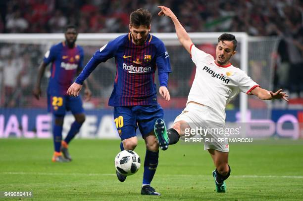 Barcelona's Argentinian forward Lionel Messi vies with Sevilla's Spanish midfielder Pablo Sarabia during the Spanish Copa del Rey final football...