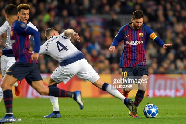 Barcelona's Argentinian forward Lionel Messi vies with Tottenham Hotspur's Belgian defender Toby Alderweireld during the UEFA Champions League group...