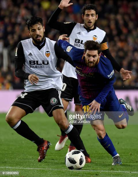 Barcelona's Argentinian forward Lionel Messi vies with Valencia's Argentinian defender Ezequiel Garay during the Spanish 'Copa del Rey' second leg...