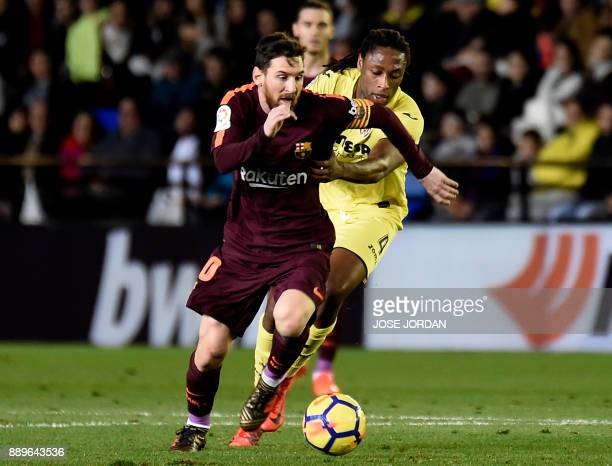 Barcelona's Argentinian forward Lionel Messi vies with Villarreal's Portuguese defender Ruben Semedo during the Spanish league football match between...