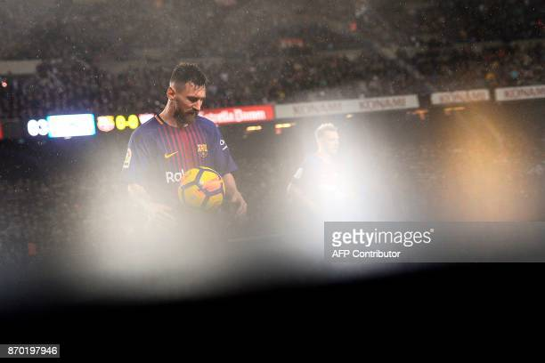 Barcelona's Argentinian forward Lionel Messi waits for the start of the Spanish league football match FC Barcelona vs Sevilla FC at the Camp Nou...