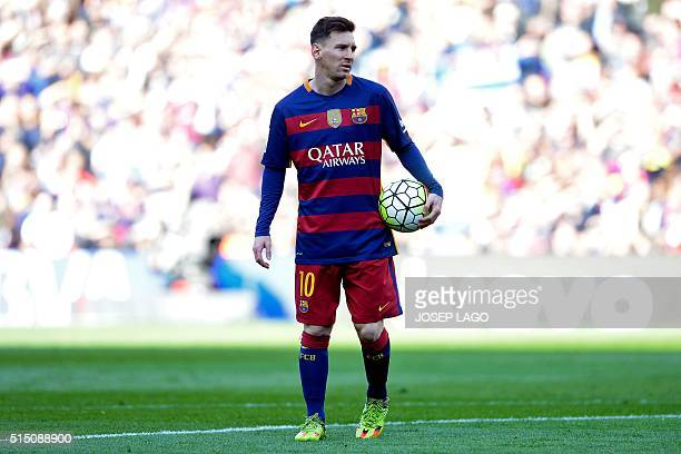 Barcelona's Argentinian forward Lionel Messi walks moments before taking a penalty kick during the Spanish league football match FC Barcelona vs...