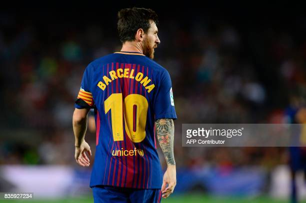 TOPSHOT Barcelona's Argentinian forward Lionel Messi walks on the pitch during the Spanish league footbal match FC Barcelona vs Real Betis at the...
