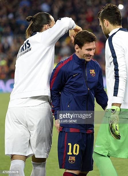 Barcelona's Argentinian forward Lionel Messi walks past Paris Saint-Germain's Swedish forward Zlatan Ibrahimovic embrace eachother before the UEFA...