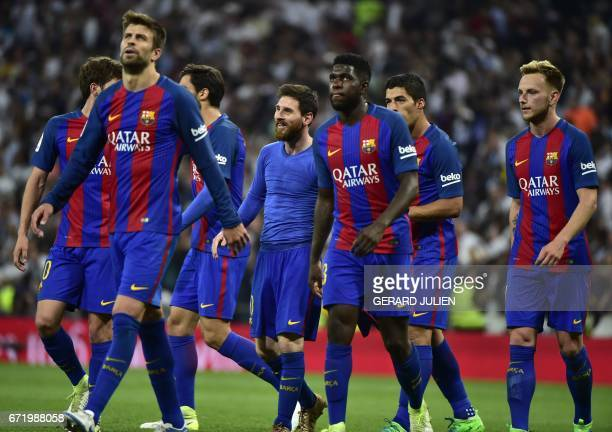 Barcelona's Argentinian forward Lionel Messi walks with his teammates after scoring Barcelon's third goal during the Spanish league football match...