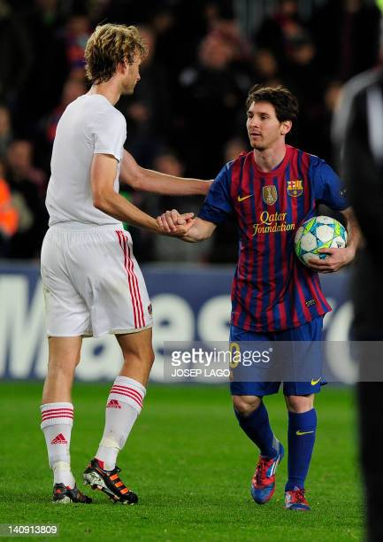 FC Barcelona's Argentinian forward Lionel Messi walks with the ball after scoring five goals during the Champions League round of sixteen second leg...