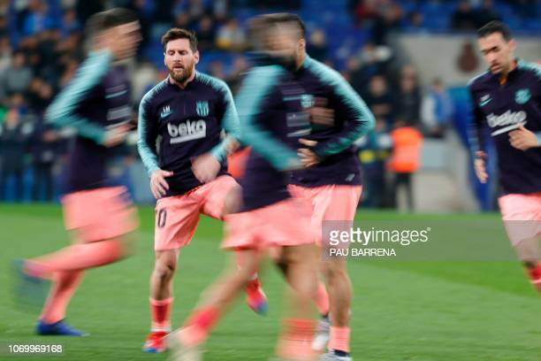 Barcelona's Argentinian forward Lionel Messi warms up before the Spanish league football match RCD Espanyol against FC Barcelona atthe RCDE Stadium...