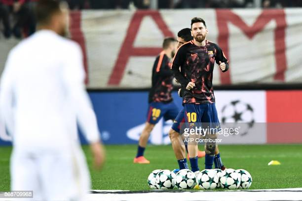 Barcelona's Argentinian forward Lionel Messi warms up prior to the UEFA Champions League group D football match between FC Barcelona and Olympiakos...