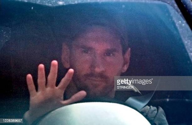 Barcelona's Argentinian forward Lionel Messi waves as he leaves his home for the Joan Gamper Ciutat Esportiva in Sant Joan Despi near Barcelona to...