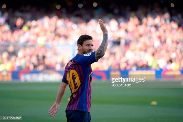 Barcelona's Argentinian forward Lionel Messi waves at fans before the 53rd Joan Gamper Trophy friendly football match between Barcelona and Boca...