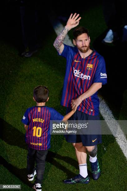 Barcelona's Argentinian forward Lionel Messi waves Barcelona's supporters at the end of the Spanish league football match between FC Barcelona and...