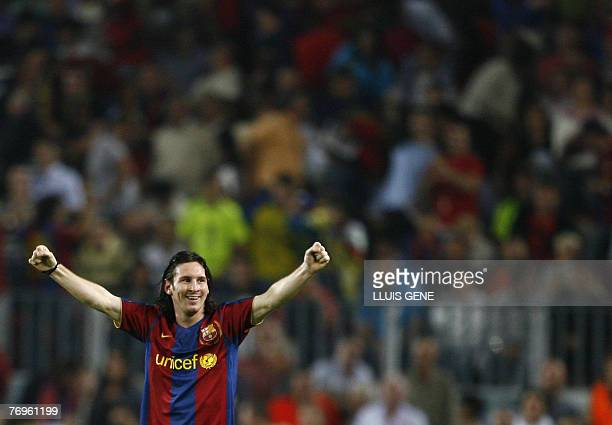 FC Barcelona's Argentinian Leo Messi celebrates the first goal against Sevilla during their Spanish League football match at Camp Nou stadium in...