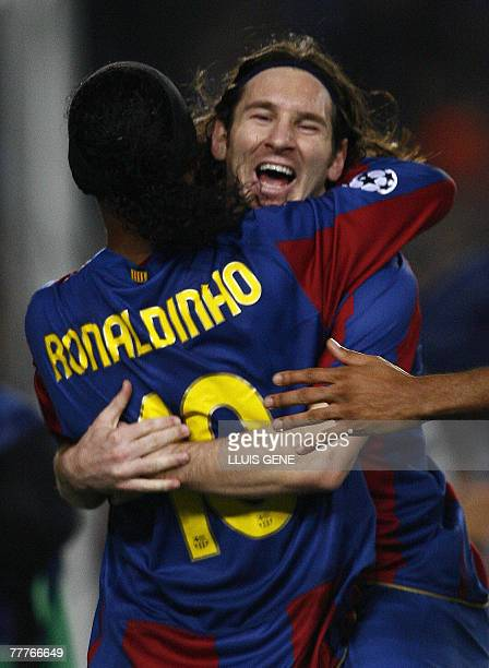 Barcelona's Argentinian Leo Messi celebrates with Brazilian Ronaldinho after scoring against Glasgow Rangers during a Champions League Group E...