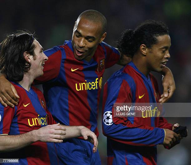 Barcelona's Argentinian Leo Messi celebrates with French Thierry Henry and Brazilian Ronaldinho after scoring against Glasgow Rangers during a...