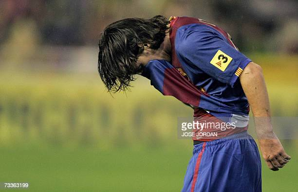 Barcelonas Argentinian Leo Messi reacts during his Spanish league football match against Valencia at Mestalla Stadium in Valencia 18 February 2007...