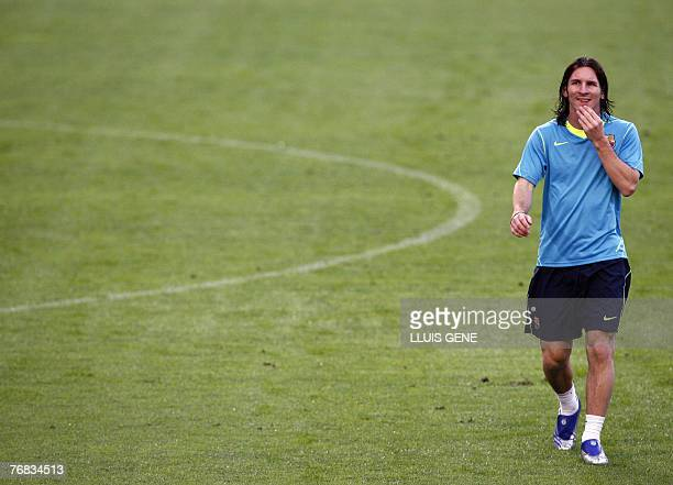 Barcelona's Argentinian Leo Messi takes part in a training session at the Camp Nou stadium 18 September 2006 in Barcelona on the eve of their...