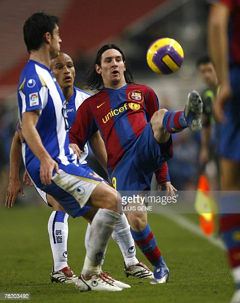 Barcelona's Argentinian Leo Messi vies with Espanyol's Riera and Clemente during their Spanish League football match at the Olympic stadium Lluis...
