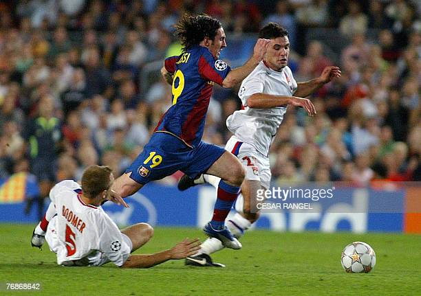 FC Barcelona's Argentinian Leo Messi vies with Olympique Lyonnais' Mathieu Bodmer and Jeremy Toulalan during their Champions League football match at...