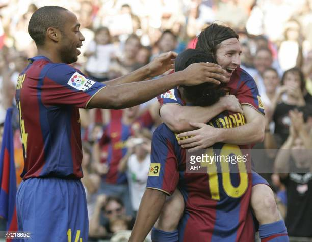 Barcelona's Argentinian Messi is congratuled by his teamates French Thierry Henry and Brazilian Ronaldinho after scoring during their Liga football...