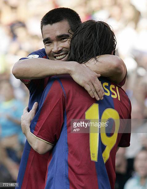 Barcelona's Argentinian Messi is congratuled by his teammate Deco after scoring during the Liga football match Barcelona against Athletico Madrid at...