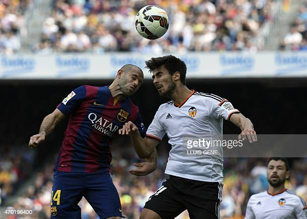 Barcelona's Argentinian midfielder Javier Mascherano vies with Valencia's Portuguese midfielder Andre Gomes during the Spanish league football match...