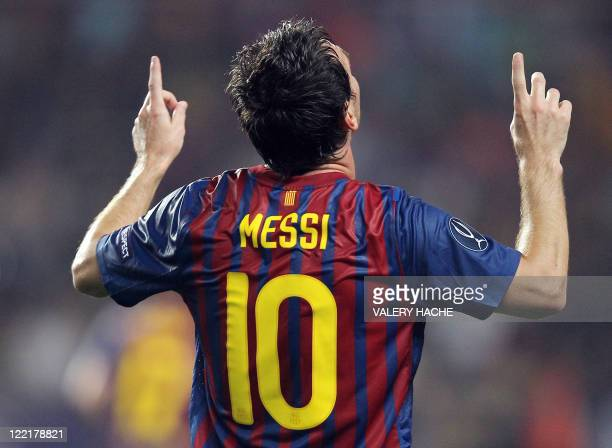 Barcelona's Argentinian midfielder Lionel Messi celebrates after scoring a goal during the UEFA Super Cup football match FC Barcelona vs FC Porto on...