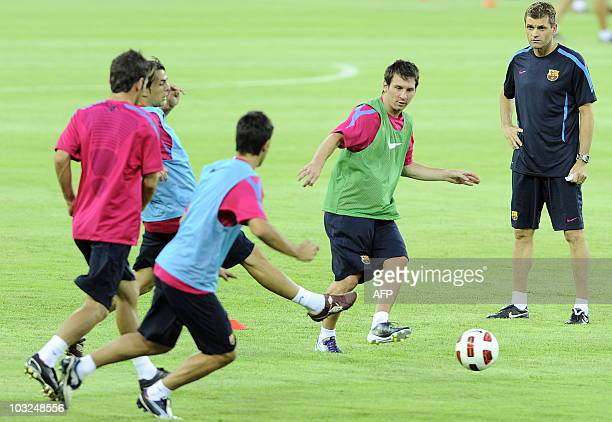 Barcelona's Argentinian midfielder Lionel Messi passes the ball during a light training session with teammates and coaches at the Worker's Stadium in...