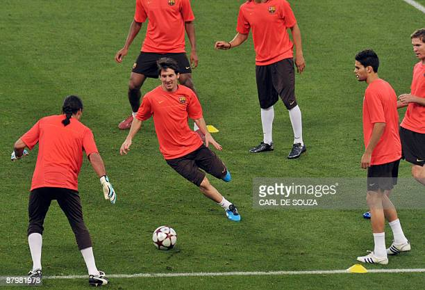 Barcelona's Argentinian midfielder Lionel Messi takes part in a training session at the Olympic stadium in Rome on May 26 2009 on the eve of the...