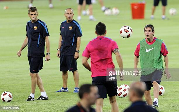 Barcelona's Argentinian midfielder Lionel Messi with teammates and coaches work out with the ball during a light training sesison at the Worker's...