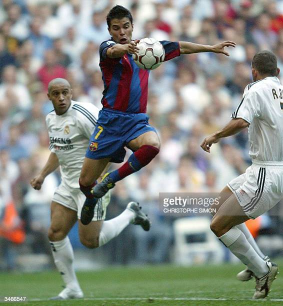 Barcelona's Argentinian Saviola fights for the ball with Real Madrid's Brazilian Roberto Carlos during the spanish first league football match Real...