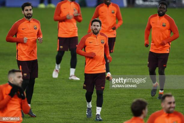 Barcelona's Argentinian striker Lionel Messi along with teammates attends a training session at Stamford Bridge stadium in London on February 19 on...