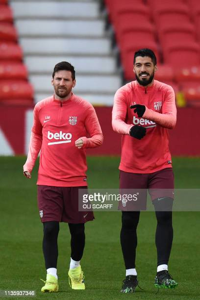 Barcelona's Argentinian striker Lionel Messi and Barcelona's Uruguayan striker Luis Suarez attend a training session at Old Trafford stadium in...