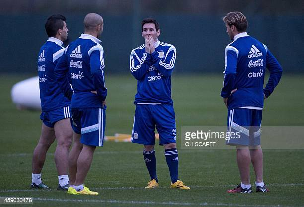Barcelona's Argentinian striker Lionel Messi and Manchester City's Argentinian striker Sergio Aguero train with the Argentina national football squad...