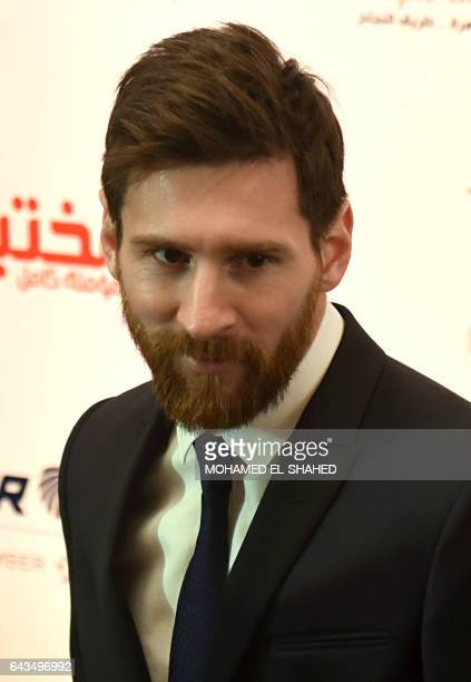 Barcelona's Argentinian striker Lionel Messi arrives for a press conference in Cairo's northern Giza district on February 21 2017 Messi arrived in...