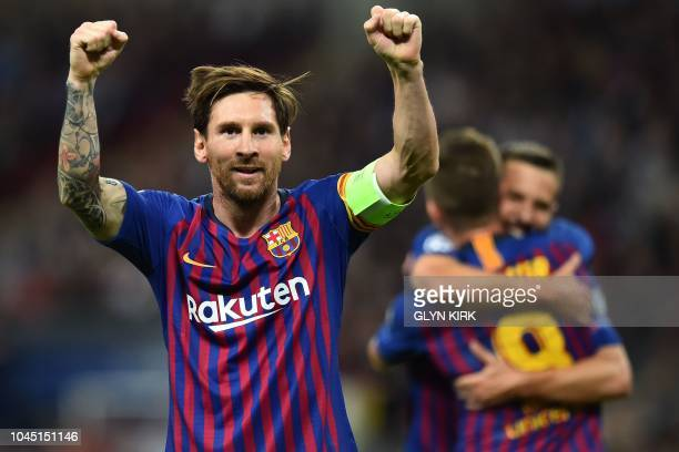 TOPSHOT Barcelona's Argentinian striker Lionel Messi celebrates after scoring their third goal during the Champions League group B football match...