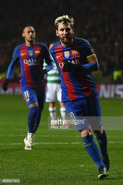 Barcelona's Argentinian striker Lionel Messi celebrates after scoring a penalty for Barcelona's second goal during the UEFA Champions League group C...