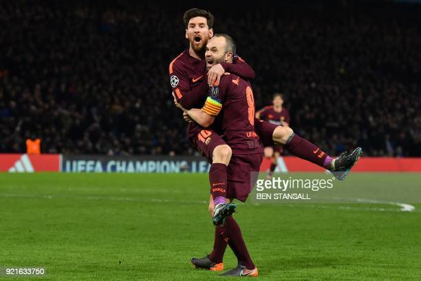 Barcelona's Argentinian striker Lionel Messi celebrates with Barcelona's Spanish midfielder Andres Iniesta after scoring their first goal during the...