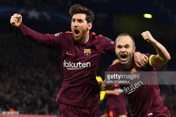 TOPSHOT Barcelona's Argentinian striker Lionel Messi celebrates with Barcelona's Spanish midfielder Andres Iniesta after scoring their first goal...