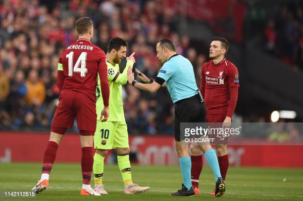 Barcelona's Argentinian striker Lionel Messi complains to the referee after being tackled by Liverpool's Scottish defender Andrew Robertson during...