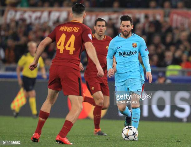 Barcelona's Argentinian striker Lionel Messi controls the ball in front of Roma's Greek defender Kostas Manolas during the UEFA Champions League...