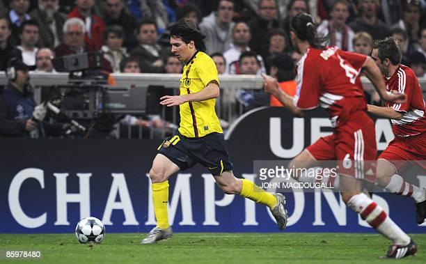 Barcelona's Argentinian striker Lionel Messi gets past Bayern Munich's Argentinian midfielder Martin Demichelis during the second leg Champions...