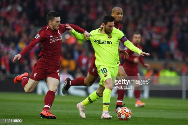 Barcelona's Argentinian striker Lionel Messi holds off Liverpool's Scottish defender Andrew Robertson during the UEFA Champions league semifinal...