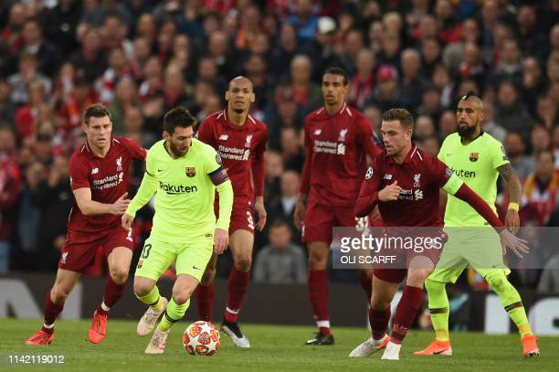 Barcelona's Argentinian striker Lionel Messi is marked by Liverpool's English midfielder Jordan Henderson during the UEFA Champions league semifinal...