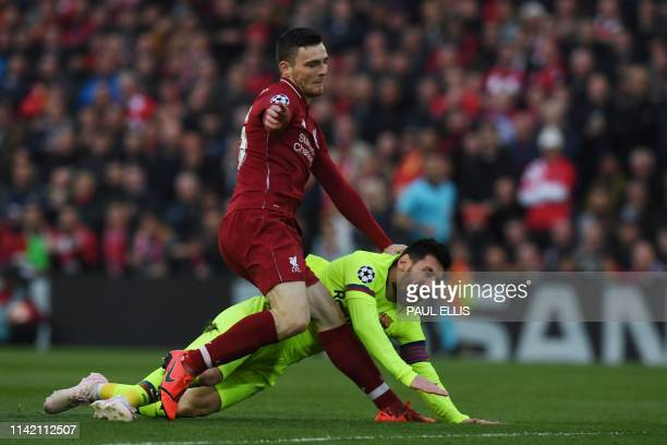 Barcelona's Argentinian striker Lionel Messi is tackled by Liverpool's Scottish defender Andrew Robertson during the UEFA Champions league semifinal...