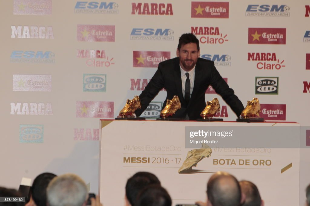 FC Barcelonas Argentinian Striker Lionel Messi Poses With His Fourth Golden Boot Trophy As Top Scorer