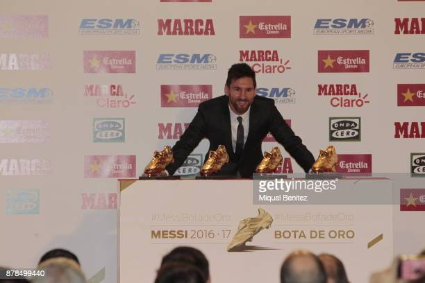 Barcelona's Argentinian striker Lionel Messi poses with his fourth Golden Boot trophy as top scorer in all European soccer leagues of the 201617...
