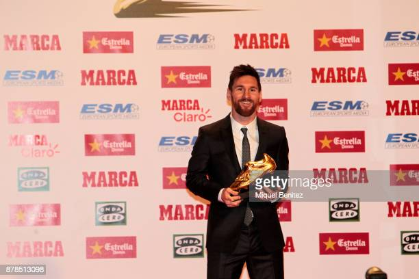 Barcelona's Argentinian striker Lionel Messi poses with his fourth Golden Boot Gala as top scorer in all European soccer leagues of the 201617 season...